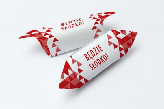 krowka-reklamowa-uniwersalna-czerwona-geometria-z-twoim-logo-1-kg-slodyczy-nadruk-dwustronny-tak-15-gramatura-papierka-